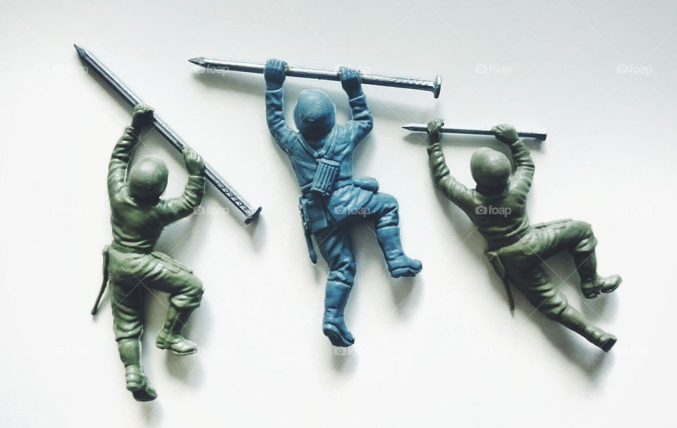 Toy soldiers with nails