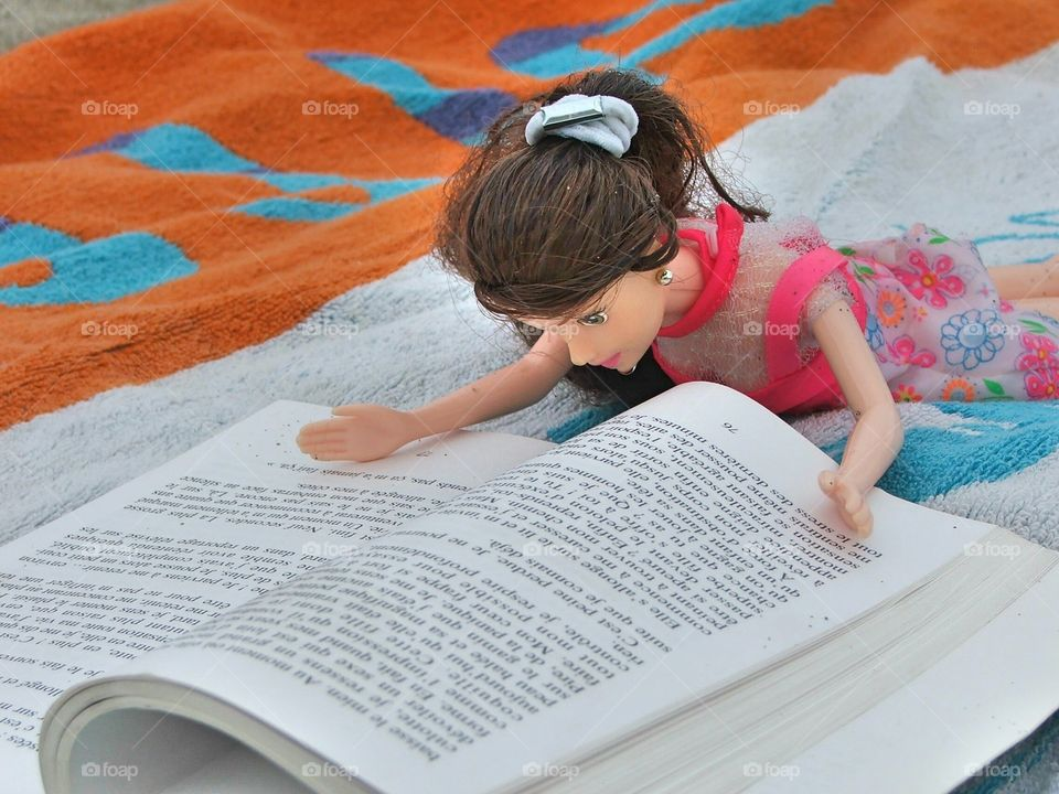 barby reading on the beach