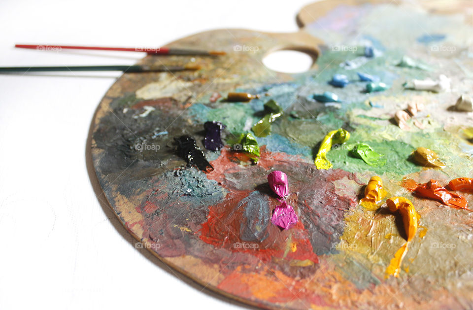 I am an artist and my hobby is painting. This is my palette with oil colors.