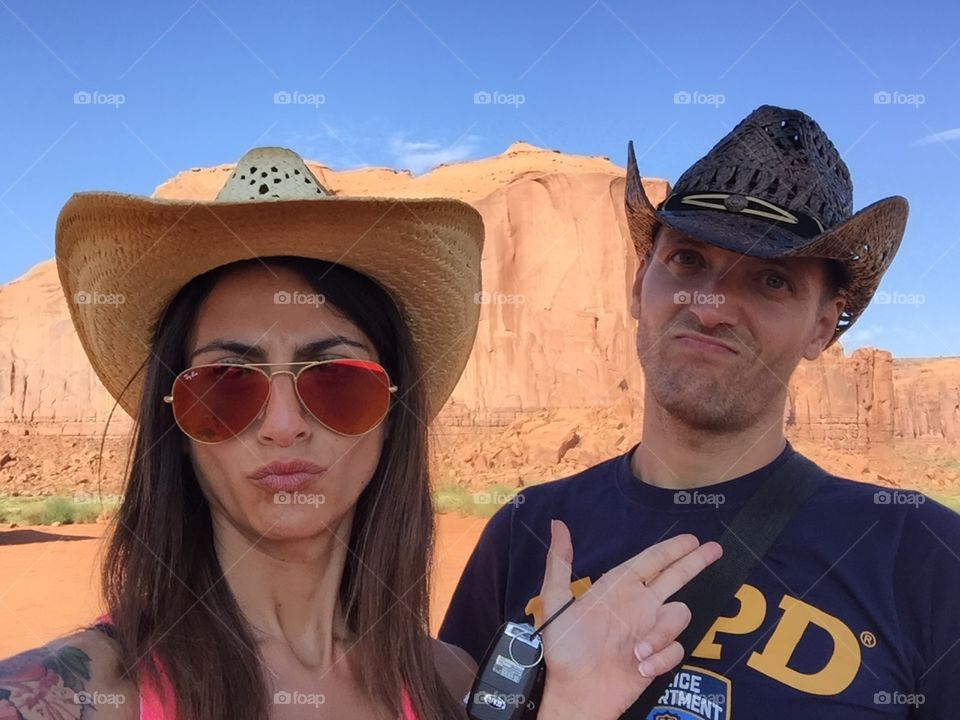 Couple of Cow boys falling in love at the monument valley tribal park