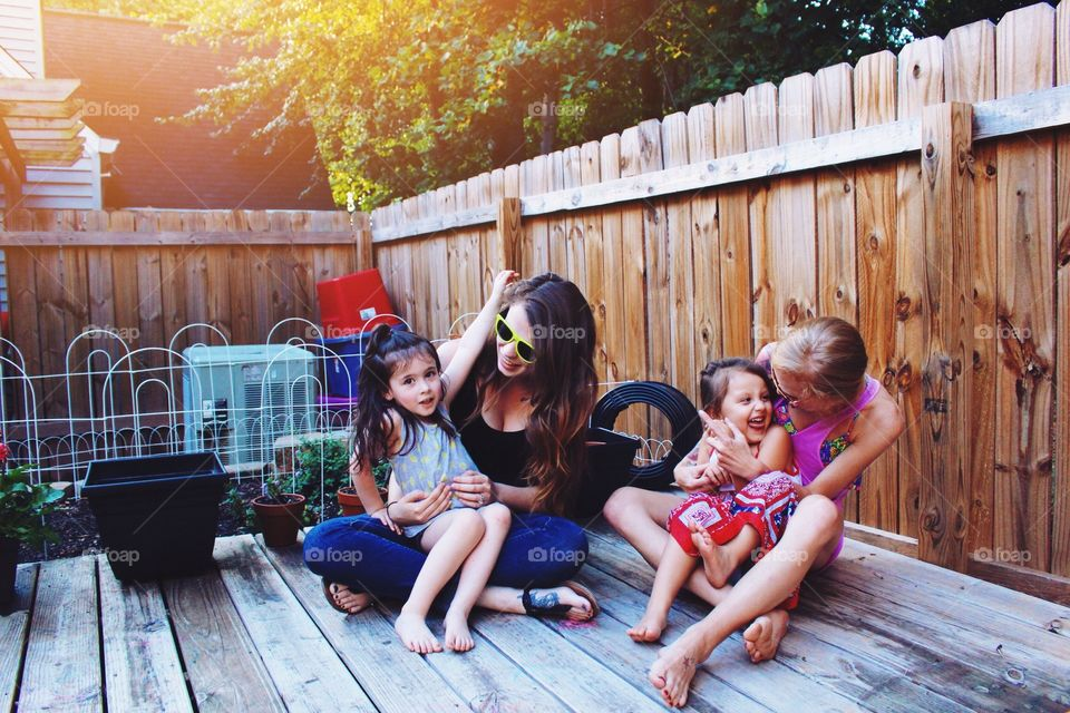 Mother enjoying with cute kids