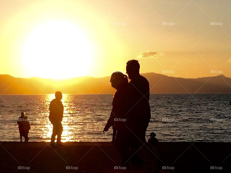 Sunset, lake and people