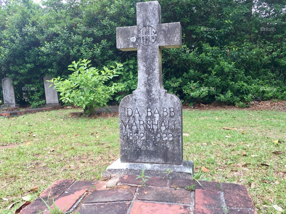Old headstone grave site in a cemetery