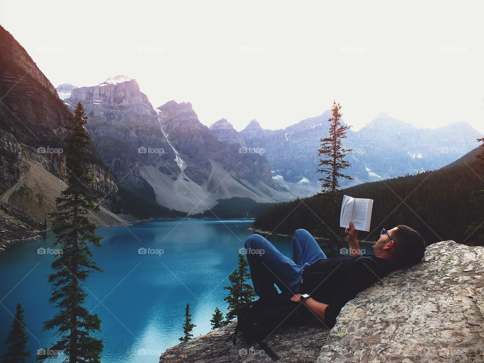 Man Reading in the pinnacle of nature Pt. 2 Beautiful scenic Mountains and lake