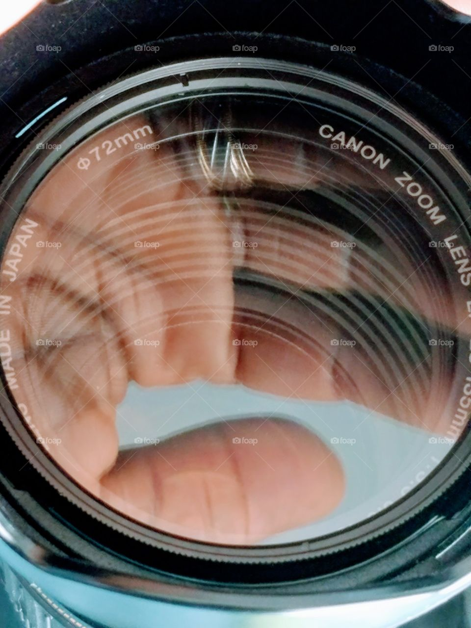 Reflection of hand on camera lens