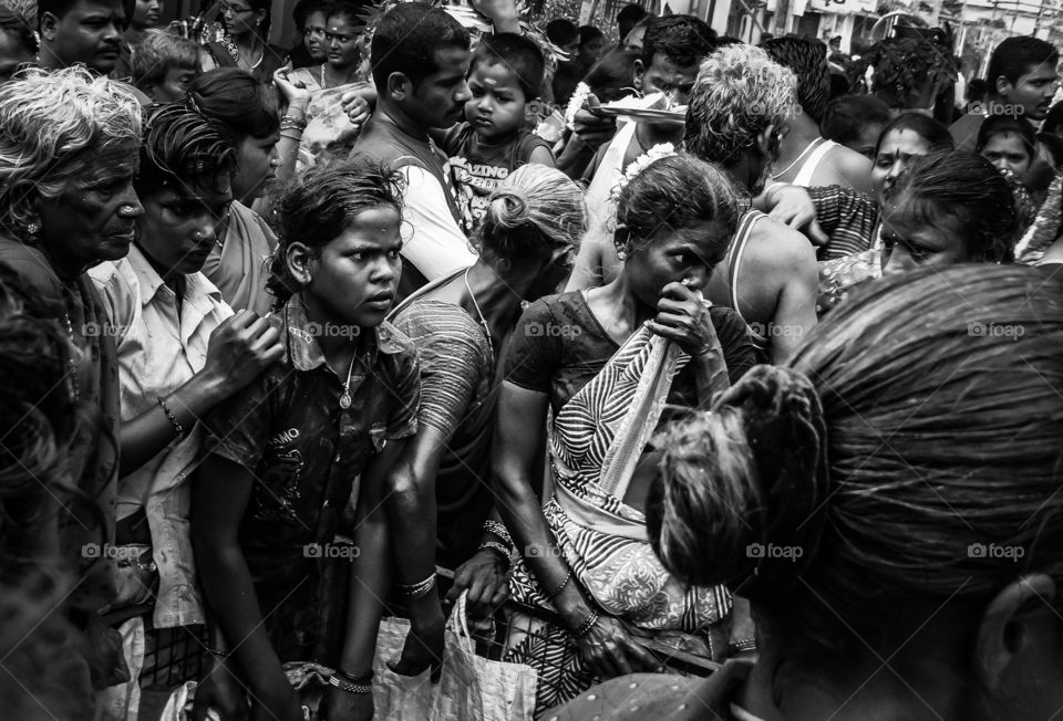 Hunger and poverty. A group of poor and hungry women waiting outside a local community temple to collect the food offered by the devotees