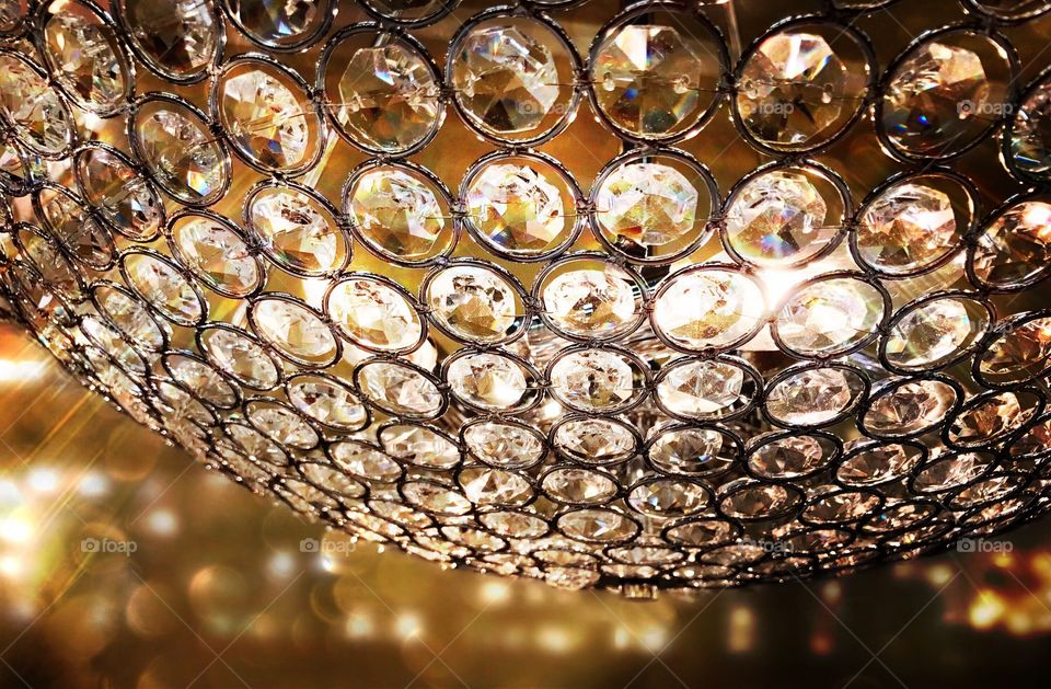 Sparkling crystal chandelier sending dazzling rainbows through the room.