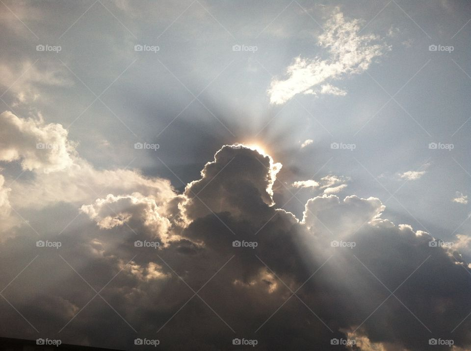 Clouds. Bright rays of sunlight from behind the clouds