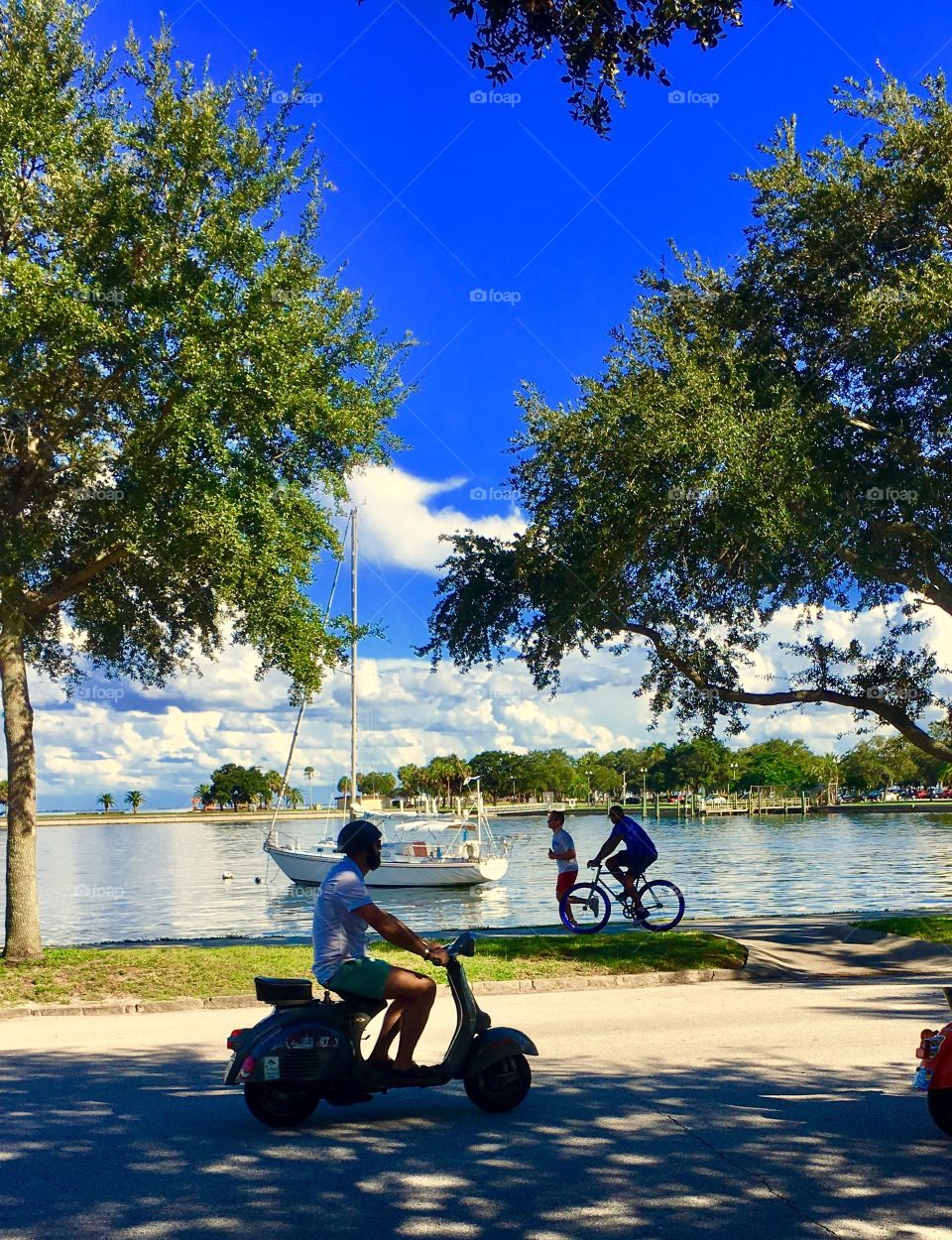 Vespa rider, jogger and Bicycler enjoying the day in St Petersburg FL