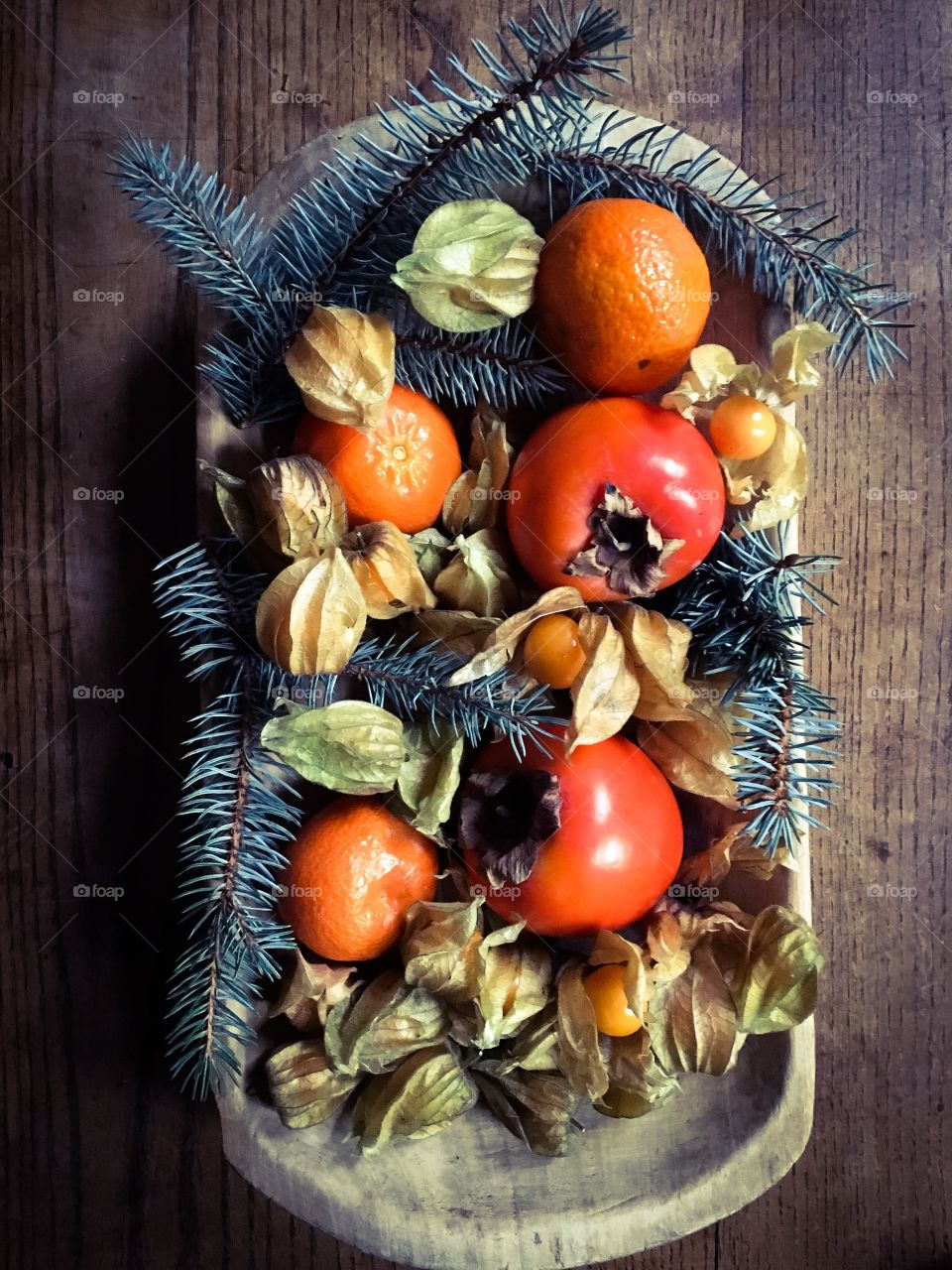 Winter fruit gathered in a wooden plate/bowl