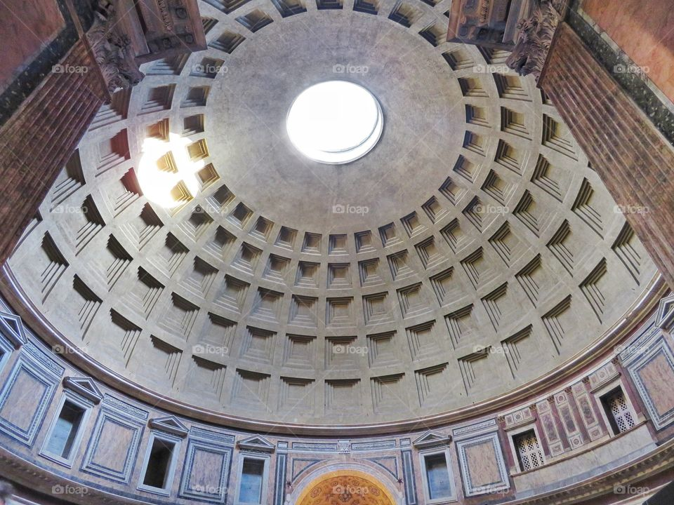 Pantheon's ceiling view from main entrance low angle. Rome