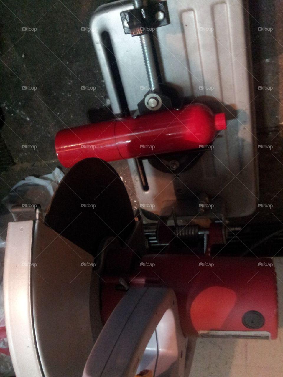 Cutting a fire extinguisher in half