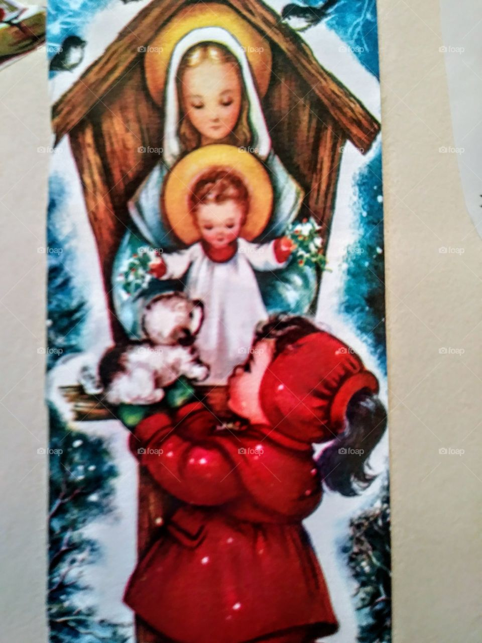 front of 1950s christmas card. mary and jesus with little girl giving jesus a puppy