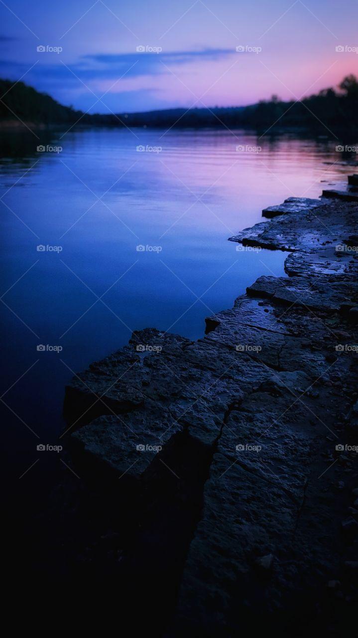 Nightfall reflections on the still water.