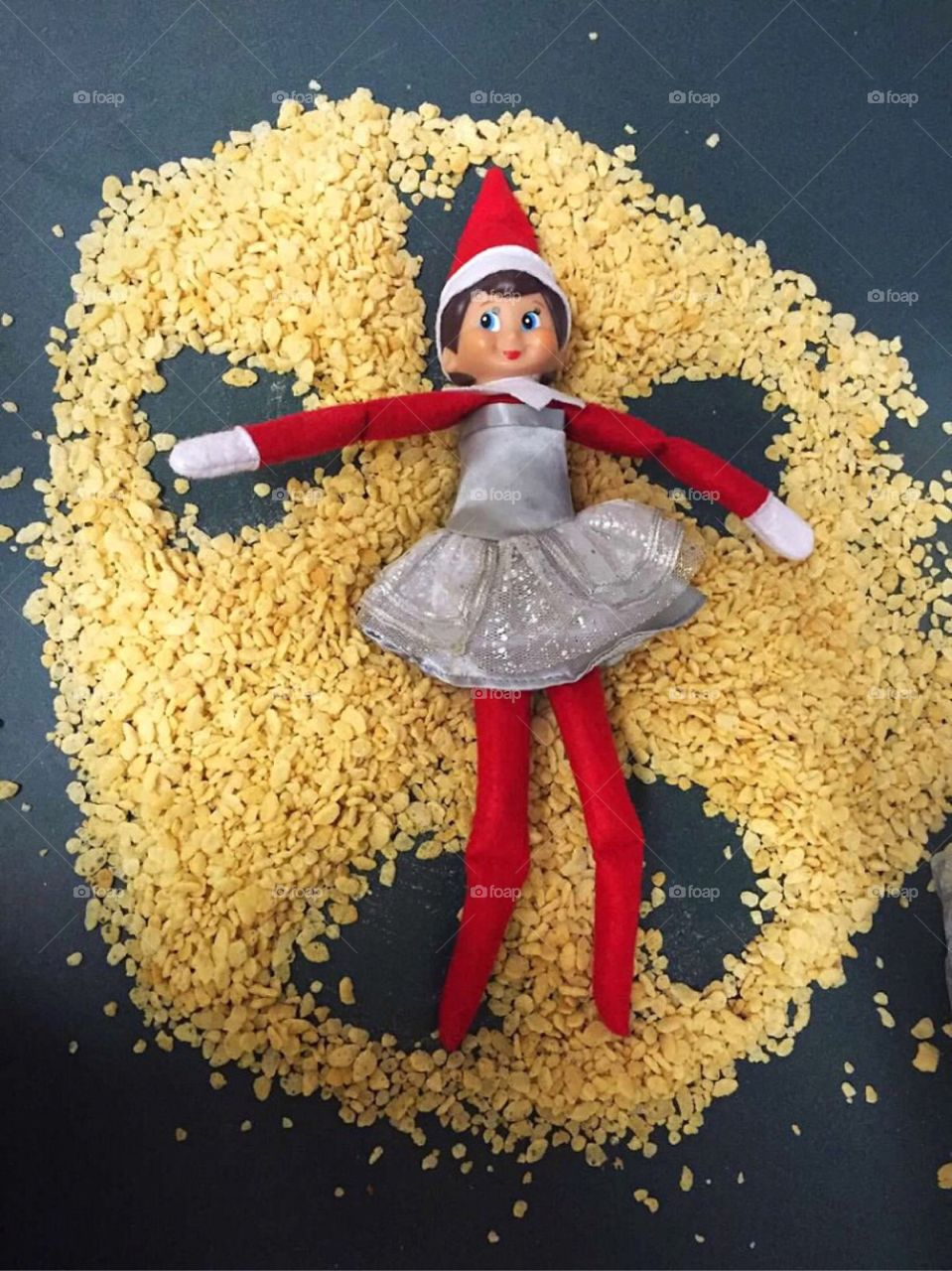 Our elf making a Rice Krispies Angel.