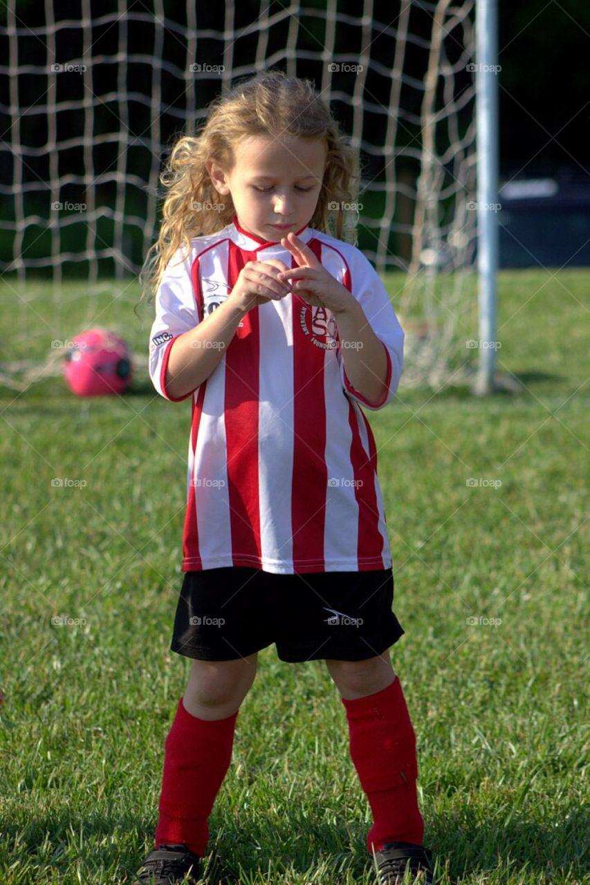 Little girl in sportswear