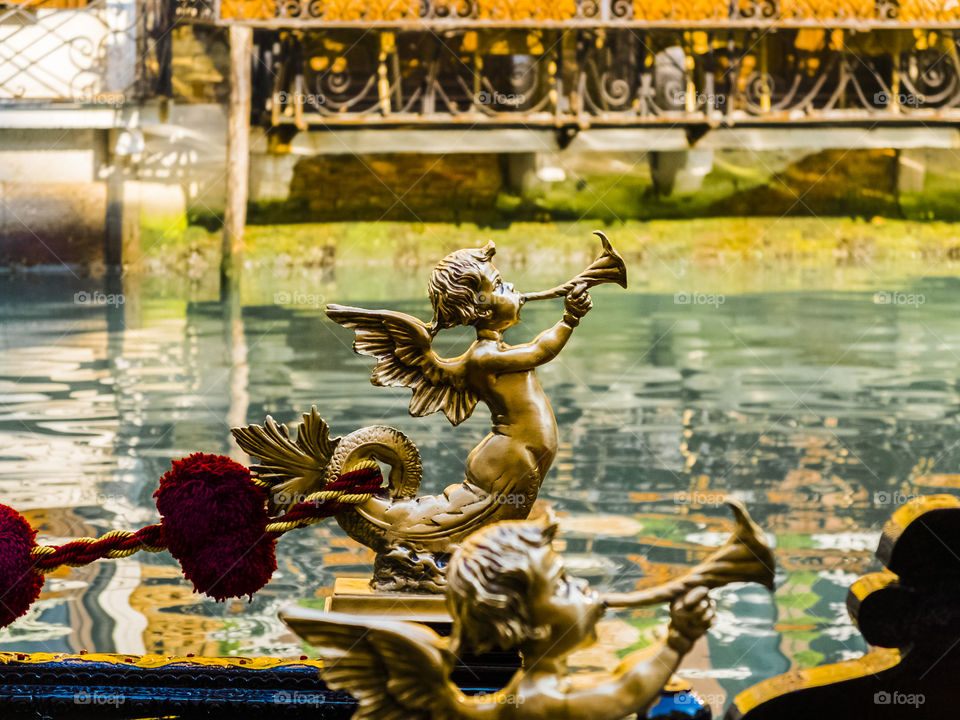 A photo, a detail ... and I see Venice on Easter. The statuette of a gondola expresses all the Venetian and Italian magic and culture. The shallow depth of field emphasizes the detail and quality of light.
