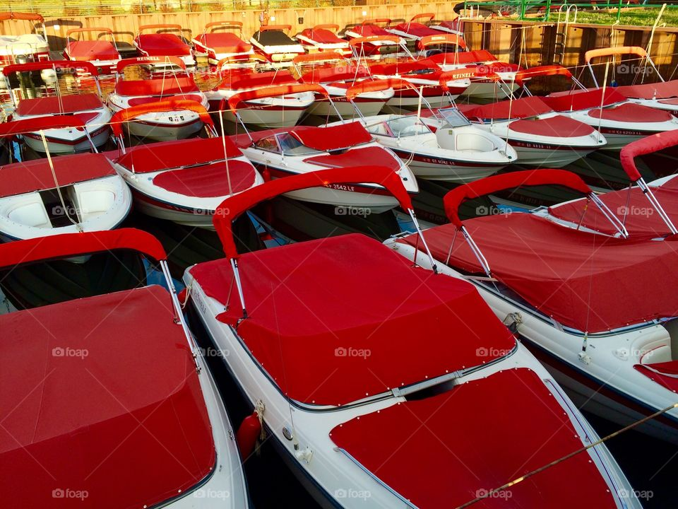 Small speedboat covered with a red tarpaulin