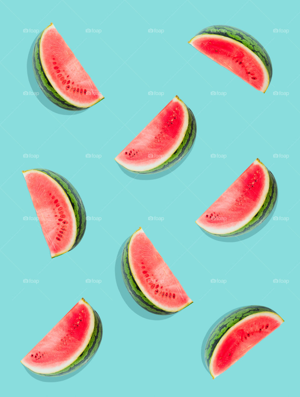 Watermelon pattern. Slices of watermelon on a plain surface painted in bright blue