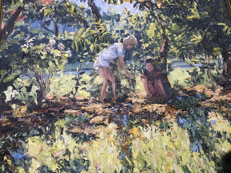 Oil painting sitting under the tree