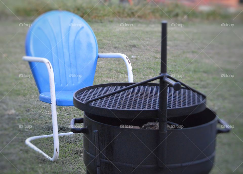 Comfy chair by the grill.