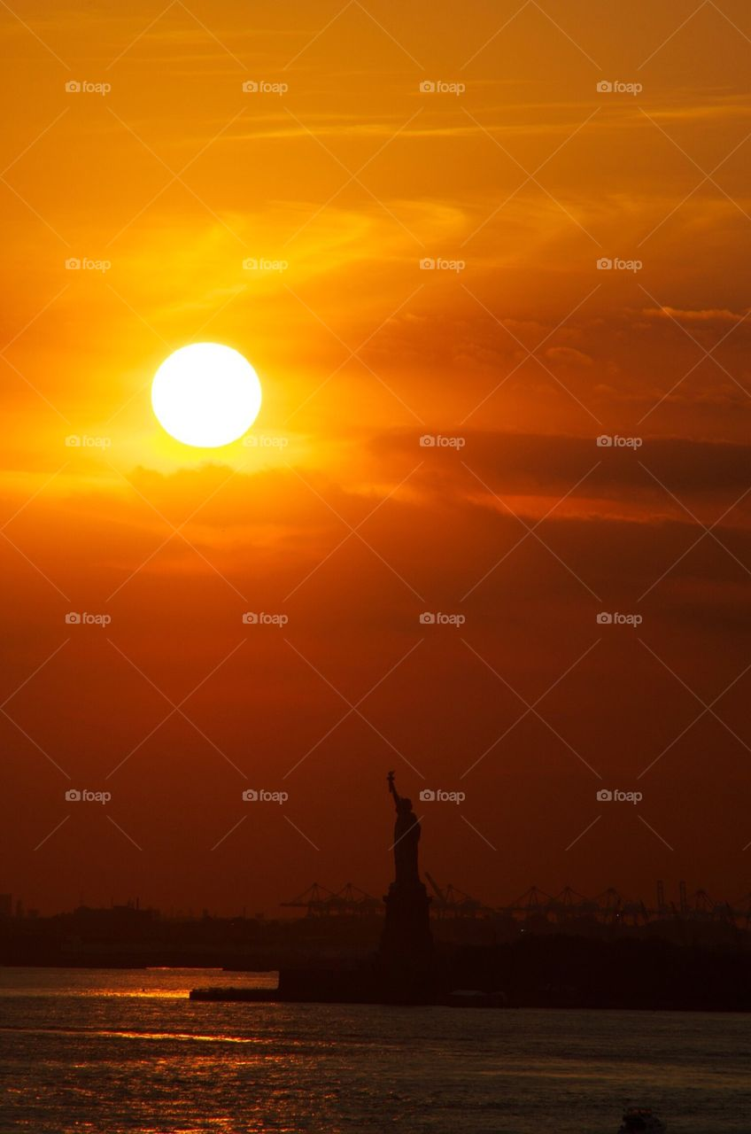 Sunset over Statue of Liberty