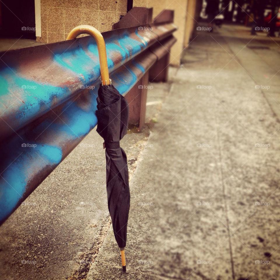 street grafitti umbrella sidewalk by jenifer_ward