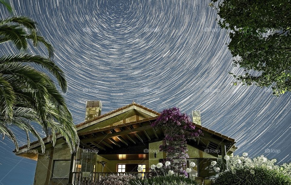Star Trails over a house in a summer night
