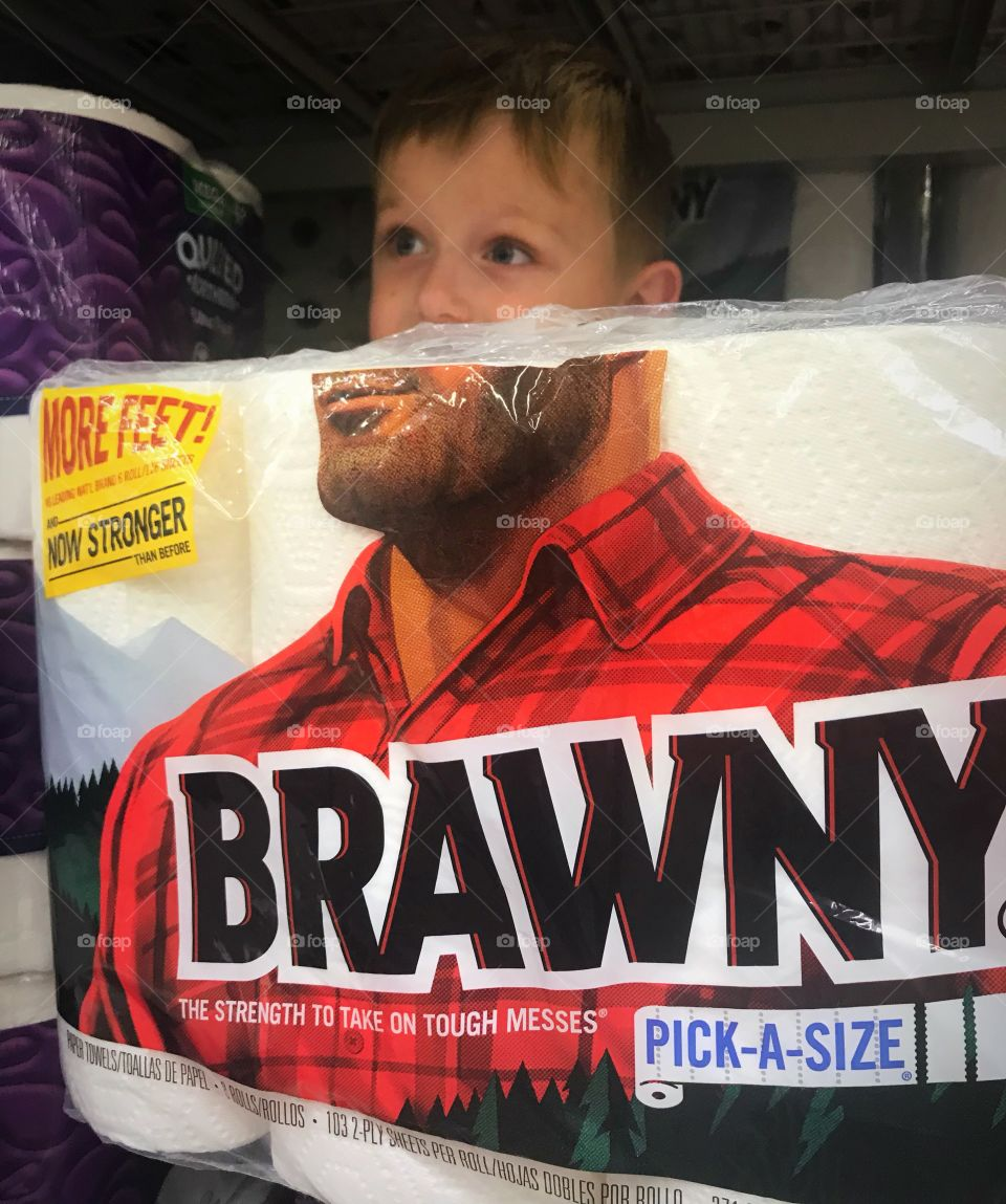 A cute little boy posing as the Brawny man while we were grocery shopping.