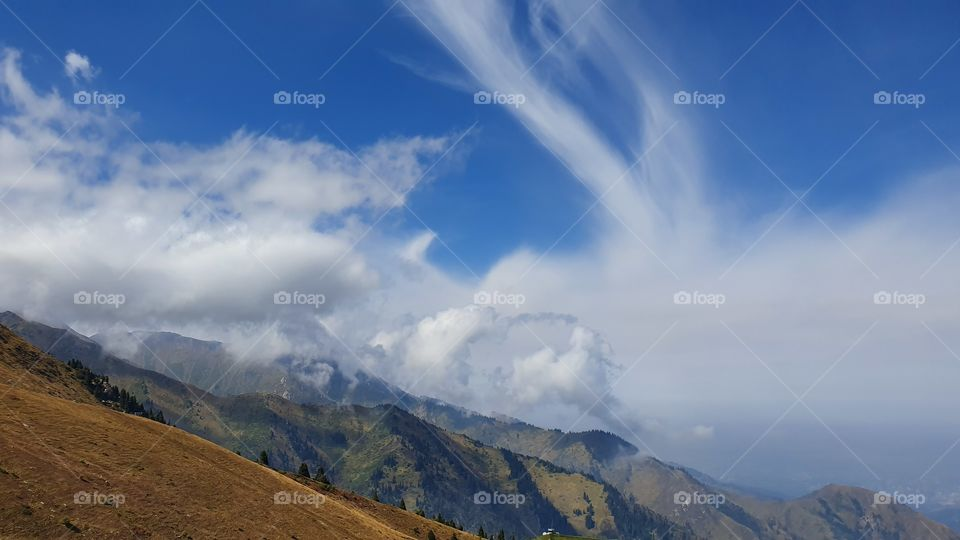 Almaty mountain peaks and clouds