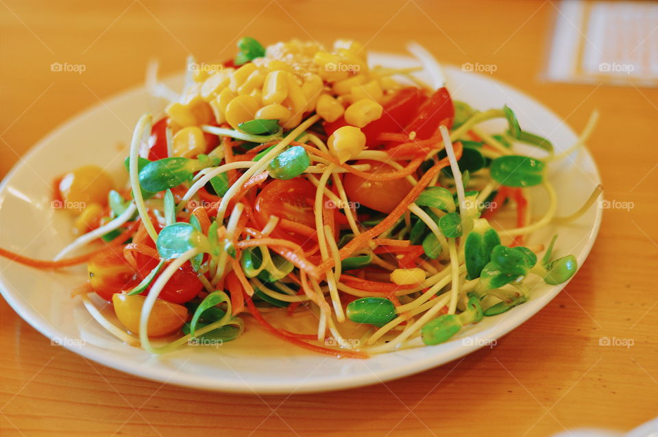Healthy Salad. Tomatoes, corn, luttuce, sunflower leaf, and carrots. This dish will make you drools over.