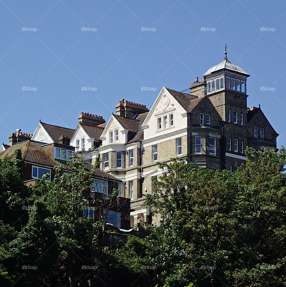 An old hotel sitting on a hill in Folkestone England on a sunny summer day.