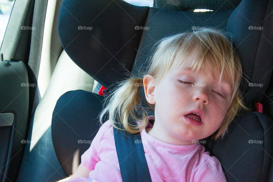Sleeping child in car.