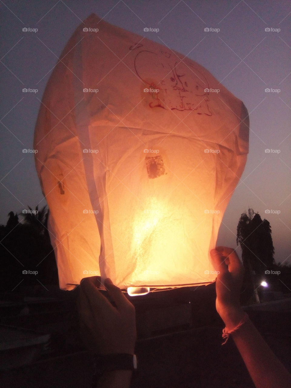 A hot air balloon is a lighter than air aircraft consisting of a bag, called an envelope, which contains heated air. Suspended beneath is a gondola or wicker basket (in some long-distance or high-altitude balloons, a capsule), which carries passengers and (usually) a source of heat, in most cases an open flame. The heated air inside the envelope makes it buoyant since it has a lower density than the colder air outside the envelope. As with all aircraft, hot air balloons cannot fly beyond the atmosphere. Unlike gas balloons, the envelope does not have to be sealed at the bottom, since the air near the bottom of the envelope is at the same pressure as the surrounding air. In modern sport balloons the envelope is generally made from nylon fabric and the inlet of the balloon (closest to the burner flame) is made from a fire resistant material such as Nomex. Modern balloons have been made in all kinds of shapes, such as rocket ships and the shapes of various commercial products, though the traditional shape is used for most non-commercial, and many commercial, applications.  The hot air balloon is the first successful human-carrying flight technology. The first untethered manned hot air balloon flight was performed by Jean-François Pilâtre de Rozierand François Laurent d'Arlandes on November 21, 1783, in Paris, France,[1] in a balloon created by the Montgolfier brothers.[2] The first hot-air balloon flown in the Americas was launched from the Walnut Street Jail in Philadelphia on January 9, 1793 by the French aeronaut Jean Pierre Blanchard.[3] Hot air balloons that can be propelled through the air rather than simply drifting with the wind are known as thermal airships. A hot air balloon is a lighter than air aircraft consisting of a bag, called an envelope, which contains heated air. Suspended beneath is a gondola or wicker basket (in some long-distance or high-altitude balloons, a capsule), which carries passengers and (usually) a source of heat, in most cases an open
