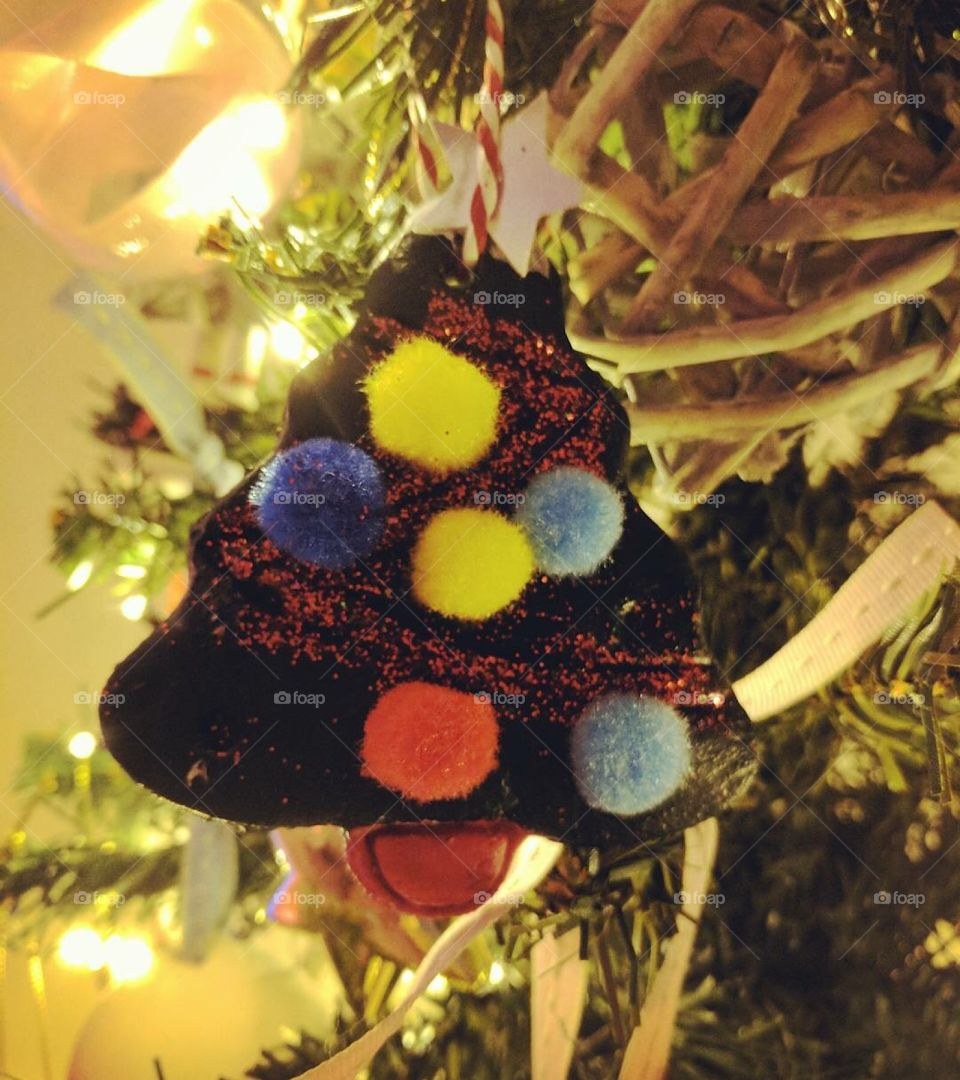Baby's first Christmas decoration close up on a tree