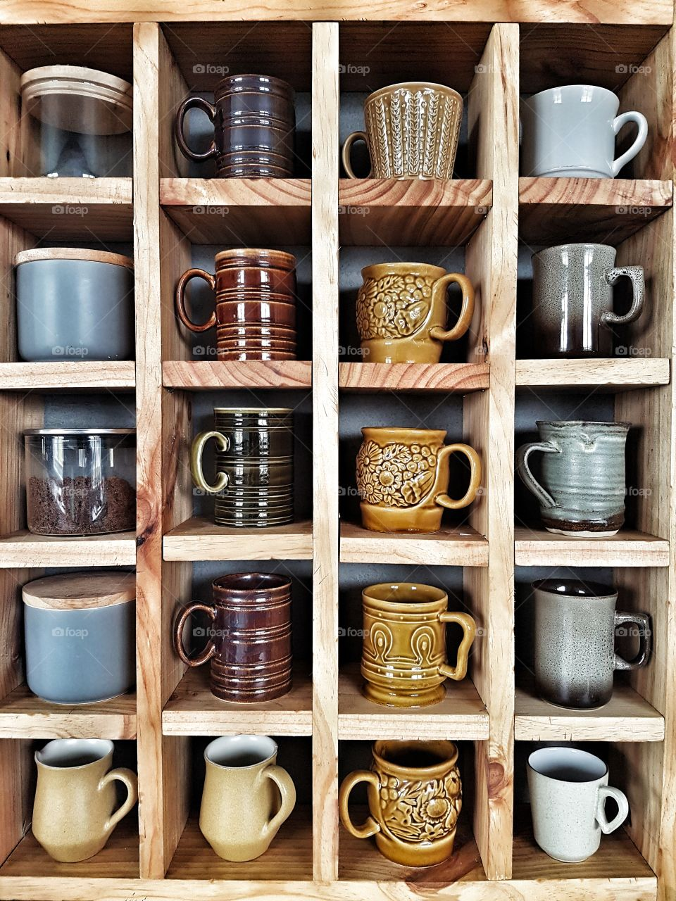 Wooden Cube shelf with vintage coffee mugs and pottery