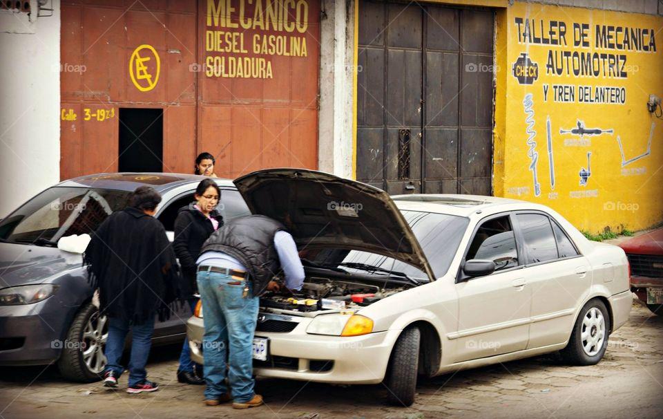 Auto mechanic fixing car in Guatemala