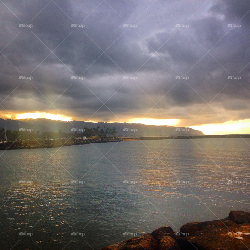 Saw the sunrays that was illuminating the ocean after the rain.