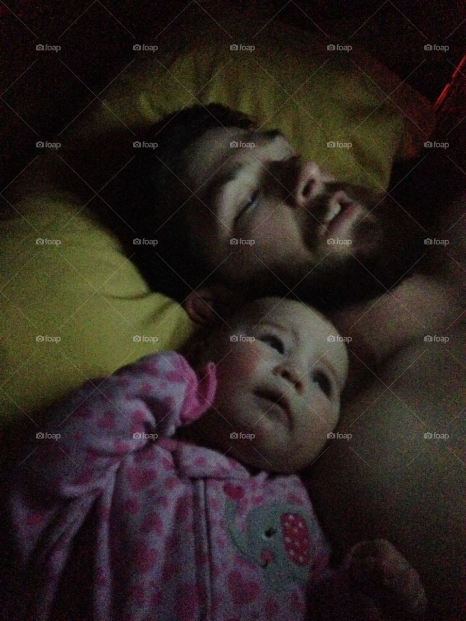 Cute daughter sleeping with his father