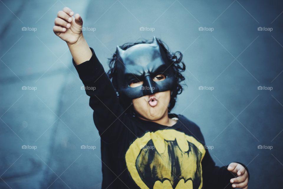 Portrait of boy wearing batman costume