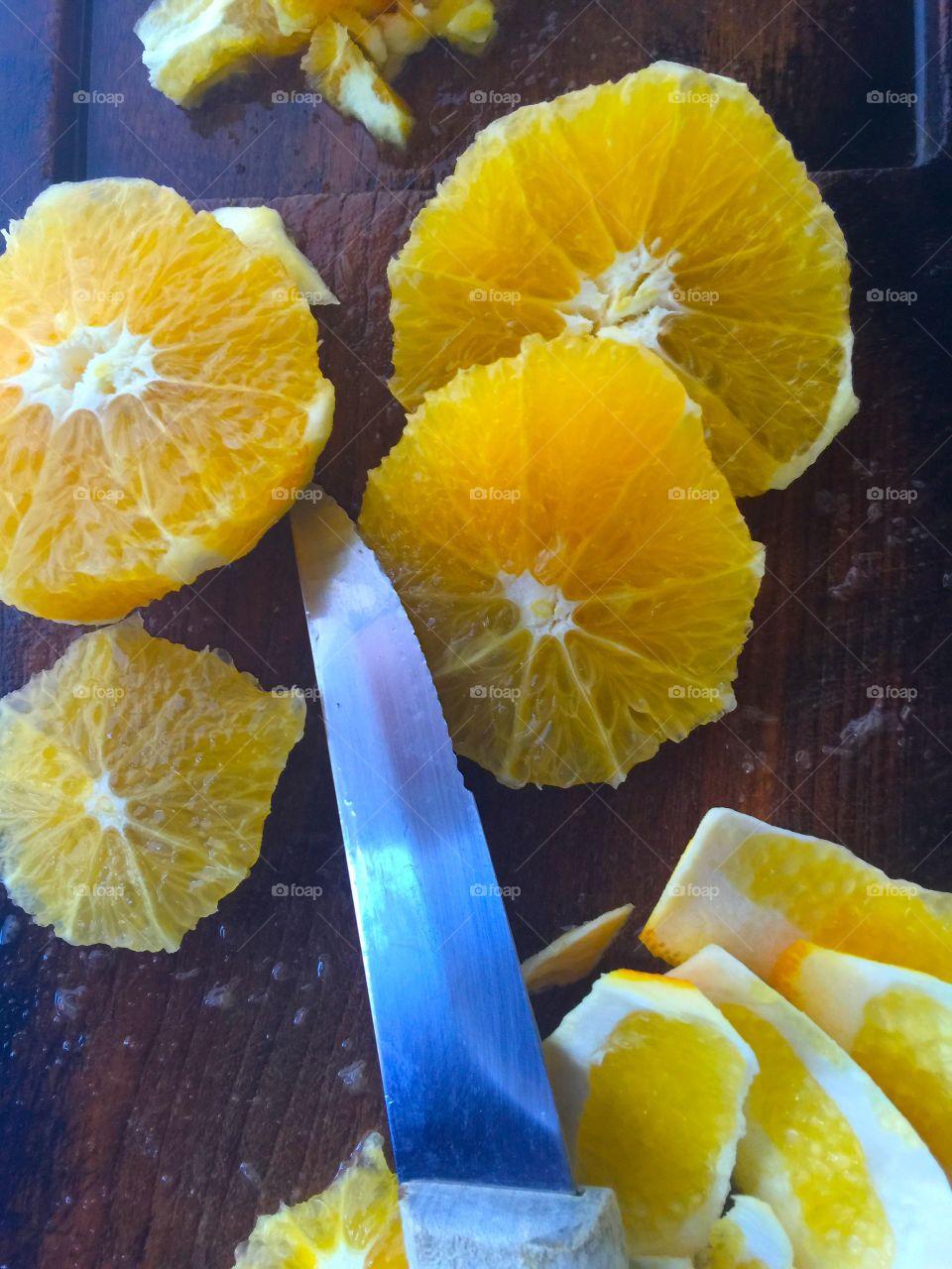 Preparing oranges for fruit salad