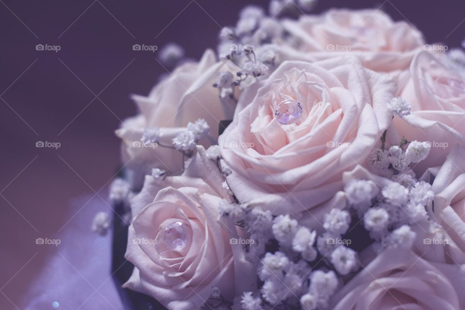 beautiful roses buoquet. white roses with crystals as bridal buoquet