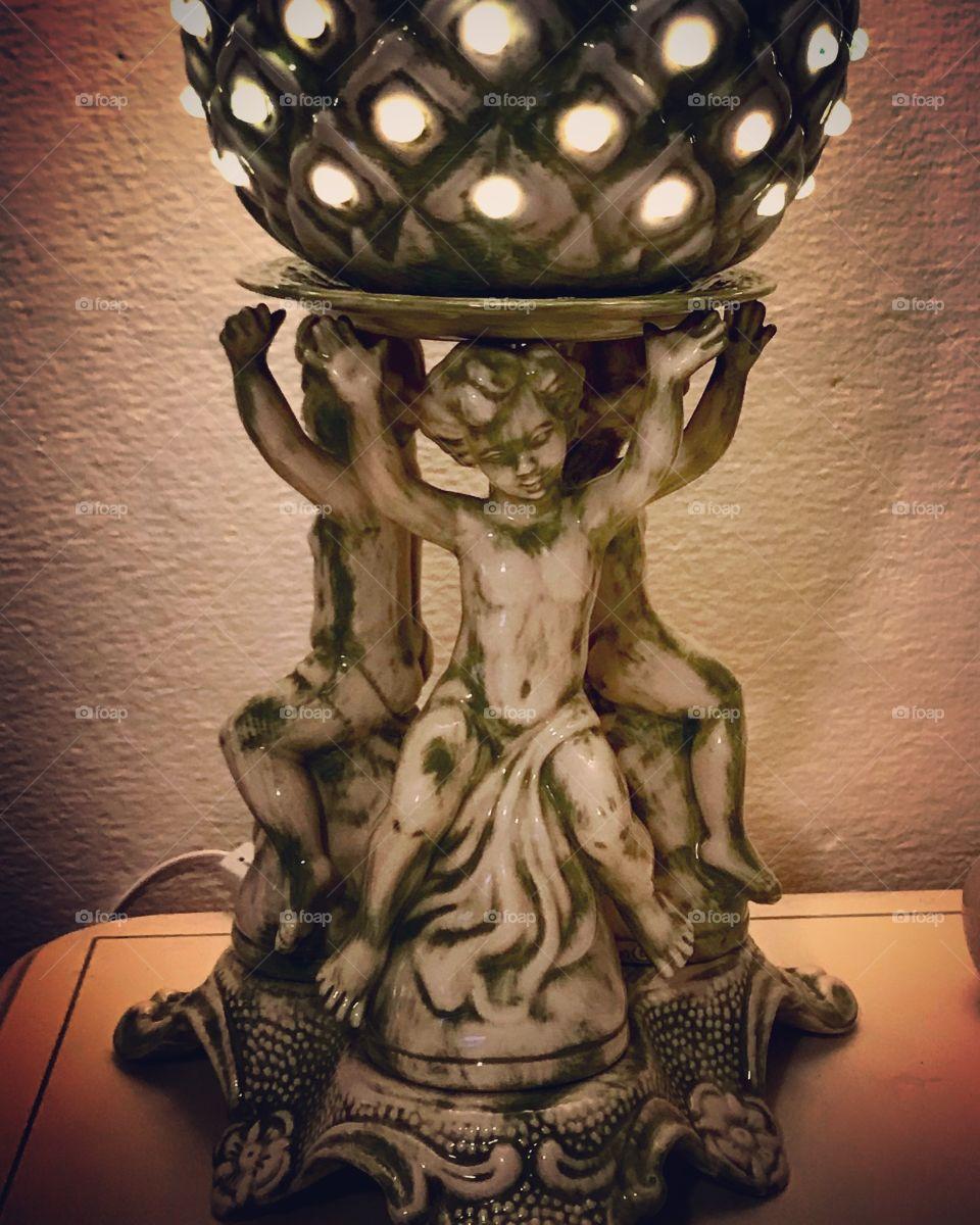 Antique green and white cherub statue lamp