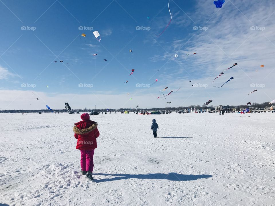 Cold stark winter time with snow covered surfaces making everything look white! Kites time!!