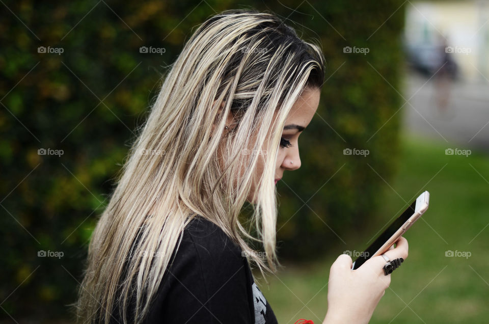 Side view of a girl using cellphone