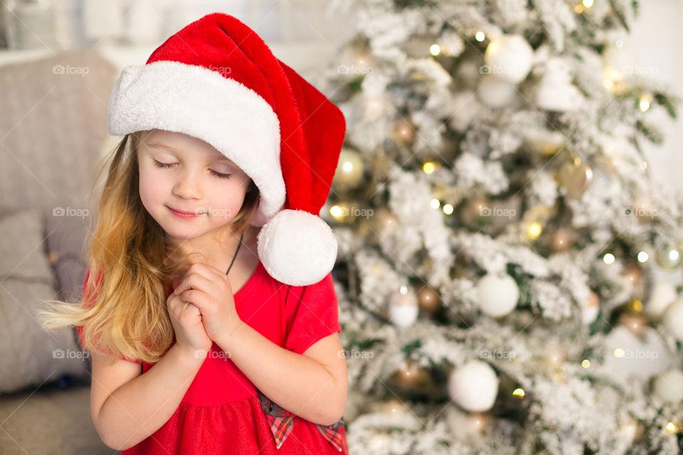 Portrait of girl wearing santa hat in christmas