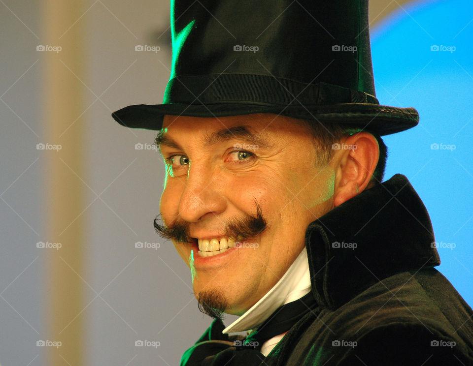 Close-up trendy man in black hat
