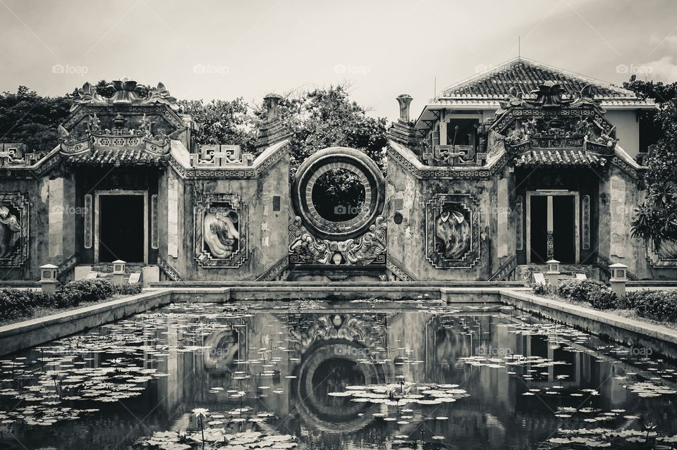 Reflections of the Ba Mu Temple Gate in Hoi An, Vietnam