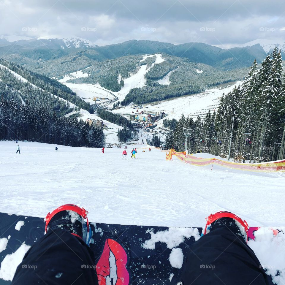 Carpatian mountains is the perfect place for snowboarding. Your heart beats so fast and you are not sure it's a good decision. But when you sit at the mountain peak and look at all this nature and beauty you understand what happiness means