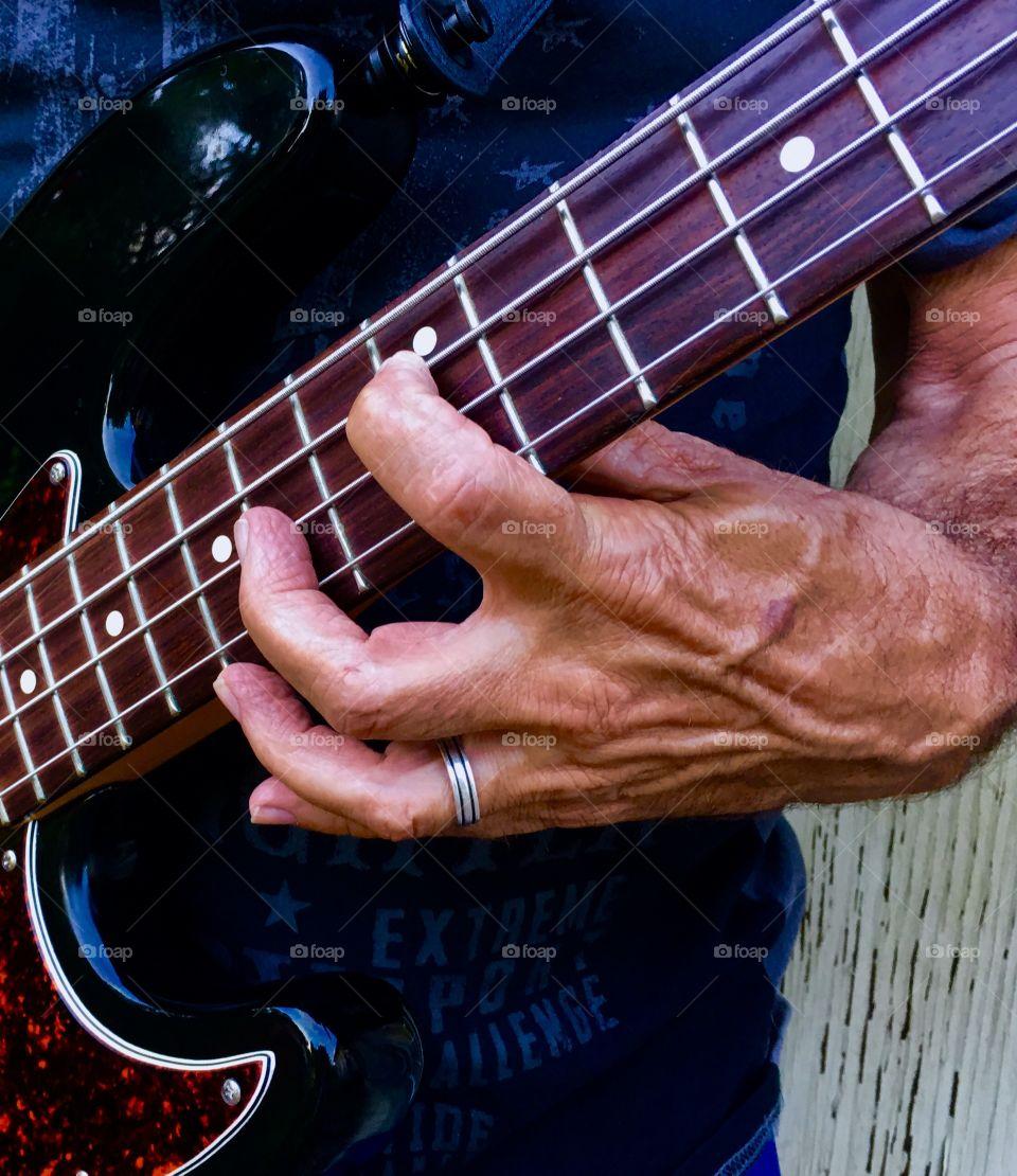 Bass guitar hand